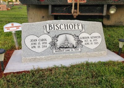 Light grey companion slant headstone with nosing