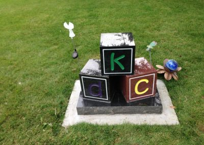 building blocks shaped headstone