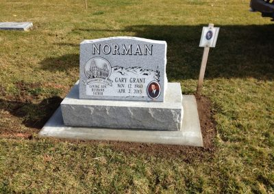 Light grey single full-face slant headstone with base