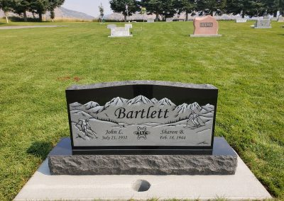 Imperial black companion upright headstone with engraved mountain and skiiers
