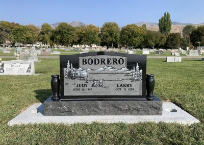 Imperial black companion upright headstone with matching granite vases